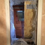 Window casing being stripped with soy based solvent