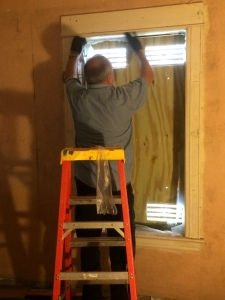 Terry prepping windows to be stripped