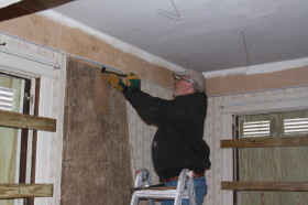 Dennis Wepfer removing suspended ceiling.